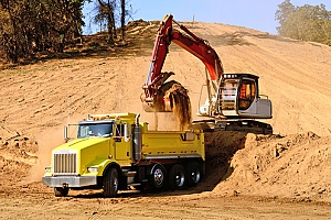 Dump truck being loaded with fill dirt.