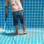 a man cleaning his inground pool and needs a pool removal