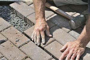 man building patio floor to prepare for outdoor kitchen