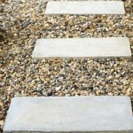 pea gravel patio ground with stepping stones