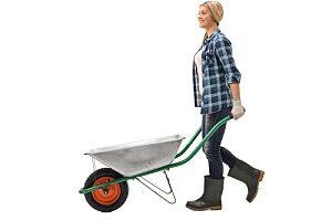woman with wheelbarrow to make a pea gravel patio