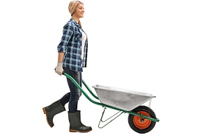 woman with wheelbarrow to make a pea gravel patio