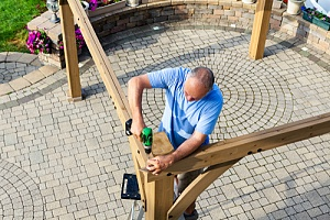 man learning how to build a gazebo