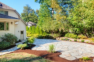 beautiful stone path with mulch surrounding in front of house