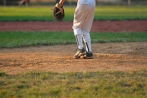 a baseball player practicing after his parents learned how to build a pitching mound in your backyard
