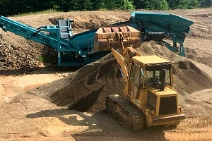 a bulldozer attempting to build up dirt around foundation