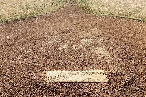 a dirt pitching mound that was built in a backyard