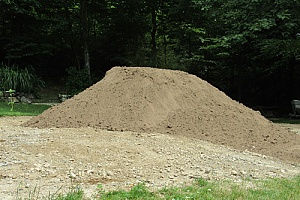 a pile of fill dirt that will be measured in cubic feet