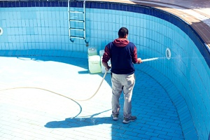a man thinking about questions to ask his pool removal contractor