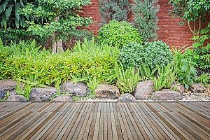a rock garden next to a ground level deck which is supported by fill dirt