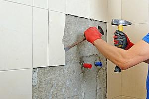 a contractor performing a bathroom renovation