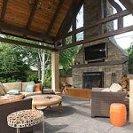 an outdoor fireplace built in a backyard