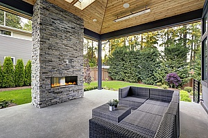 the backyard of a homeowner who learned how to build an outdoor fireplace