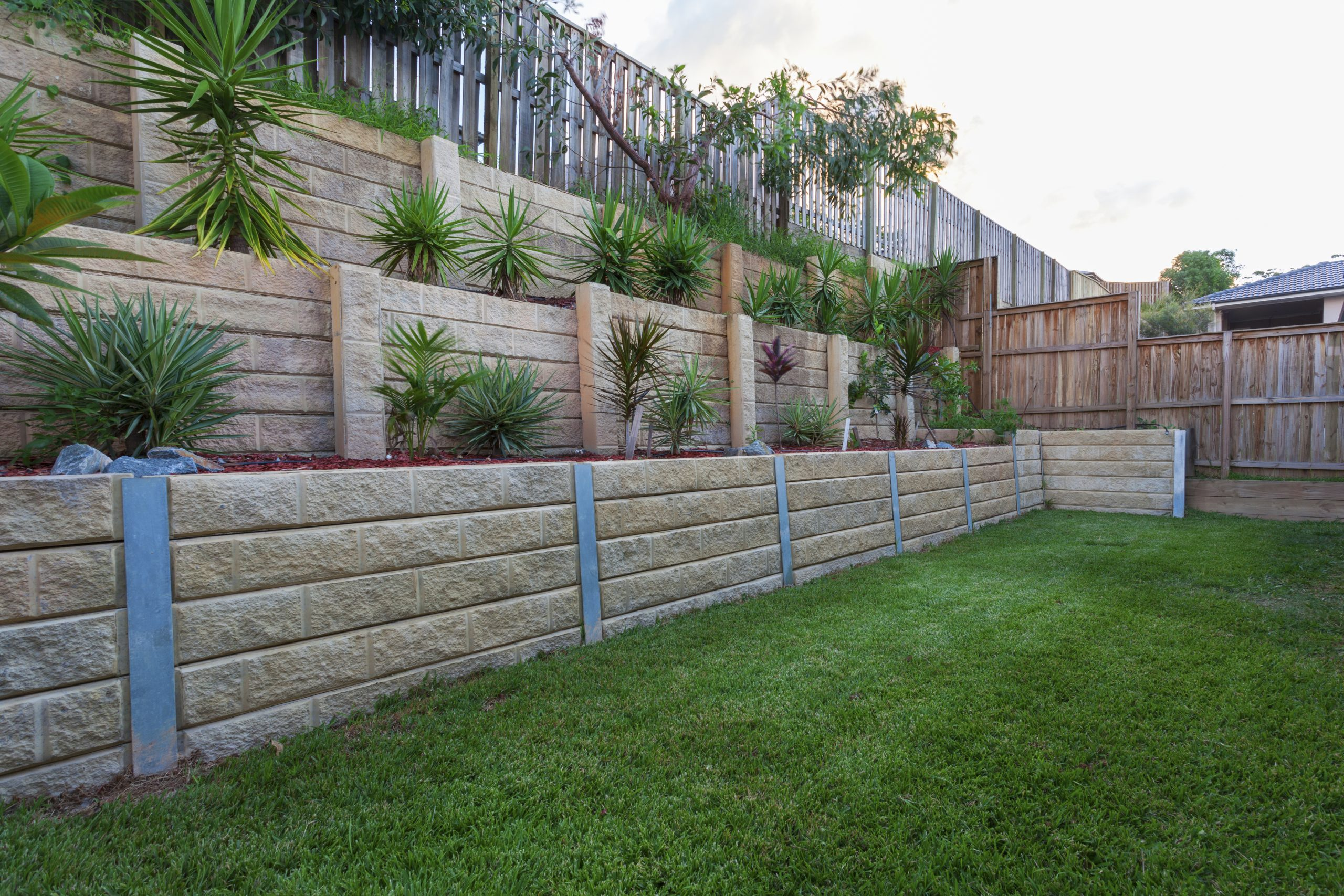 Multi tiered newly constructed retaining wall.