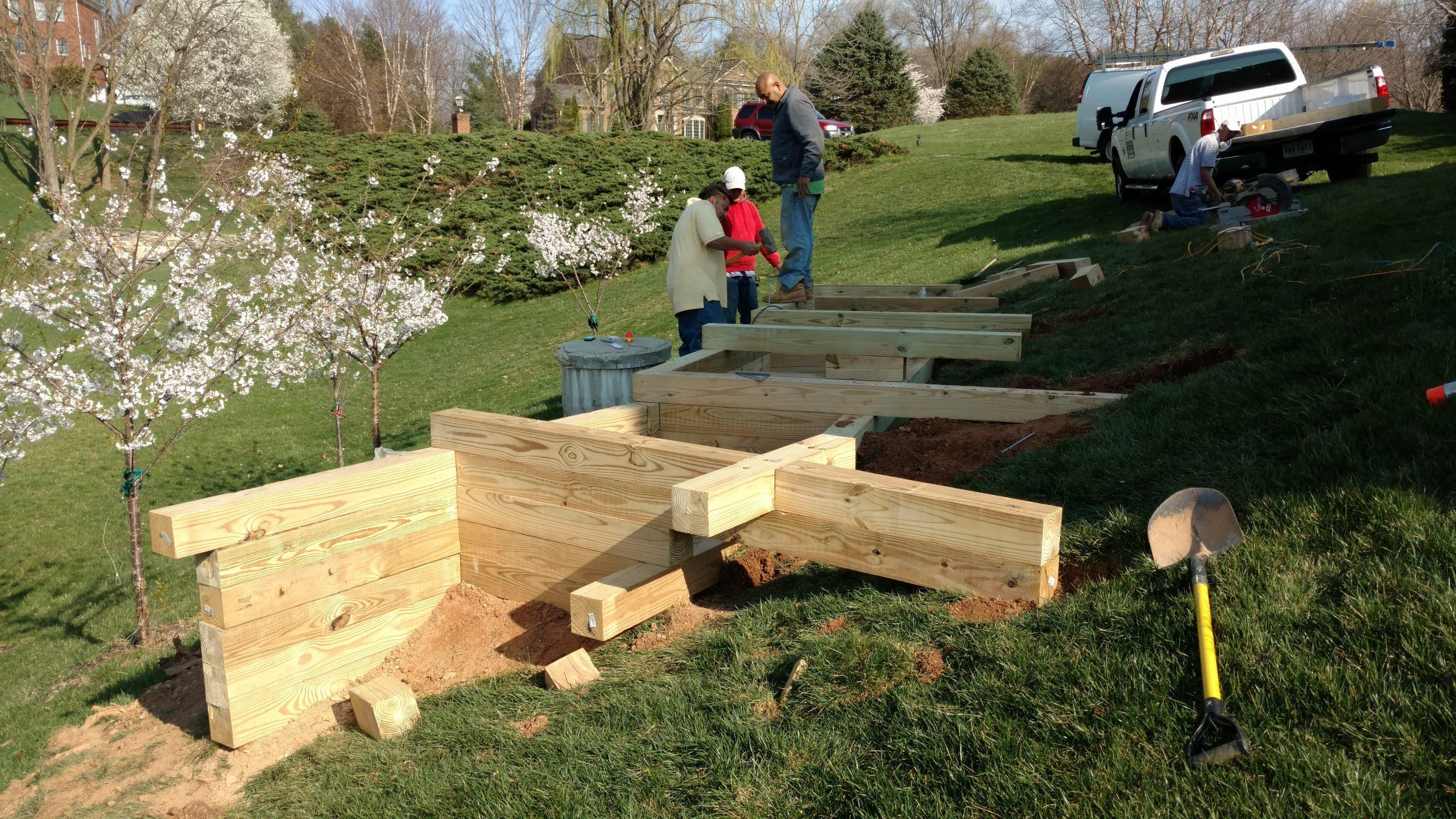 Pressure treated 6 x 6 wood retaining wall.