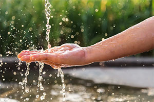 Hands with water splash