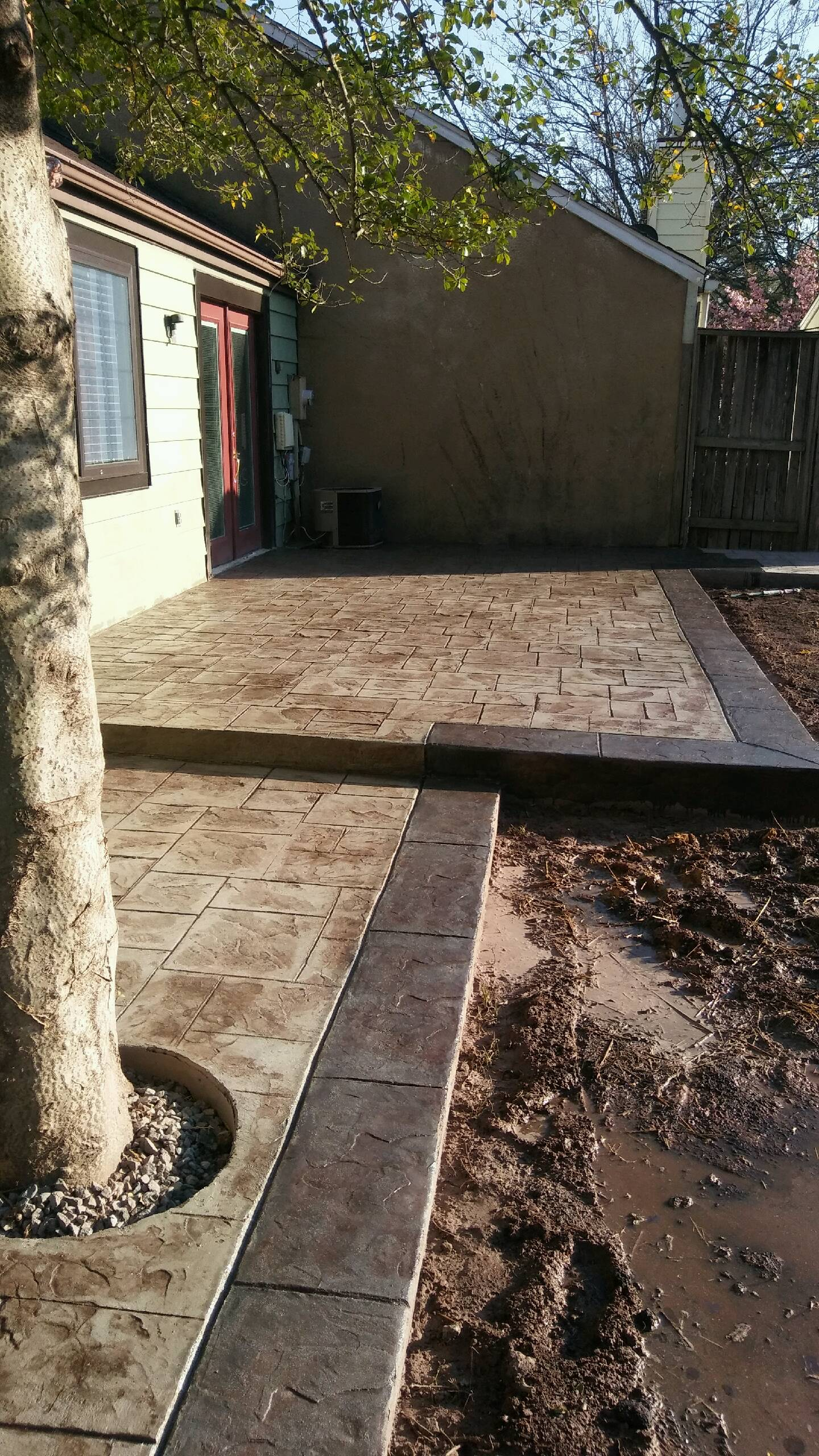 Stamped and stained new concrete patio work