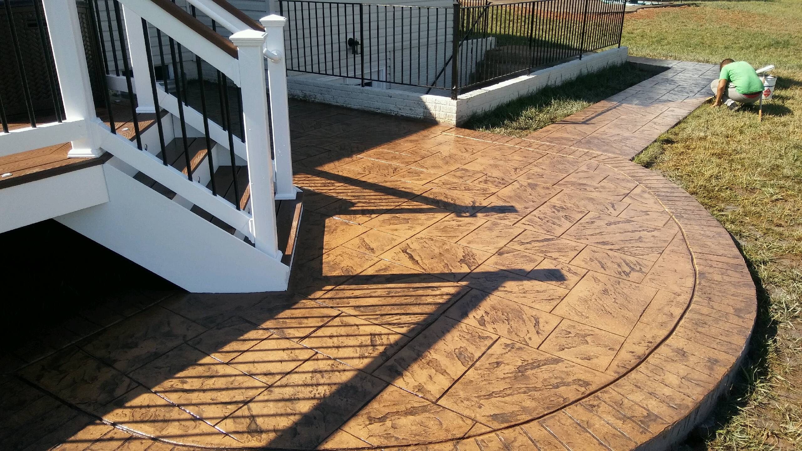 New stamped concrete patio and sidewalk