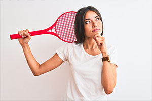 Woman wondering how to build a tennis court