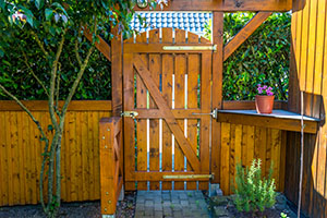 Wooden gate and fence on the back of the home garden