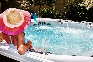 a woman enjoying a relaxing day in a hot tub