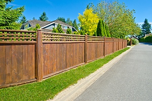 Brown privacy fence surrounding home