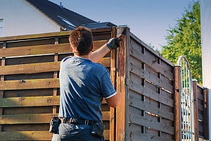 Contractor building privacy fence