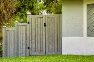 Double Gates of Gray Composite Fence