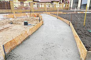 Gravel base for a concrete driveway