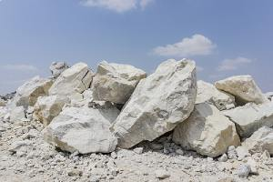 A pile of limestone in a quary. Limestone is the most common way to raise soil pH