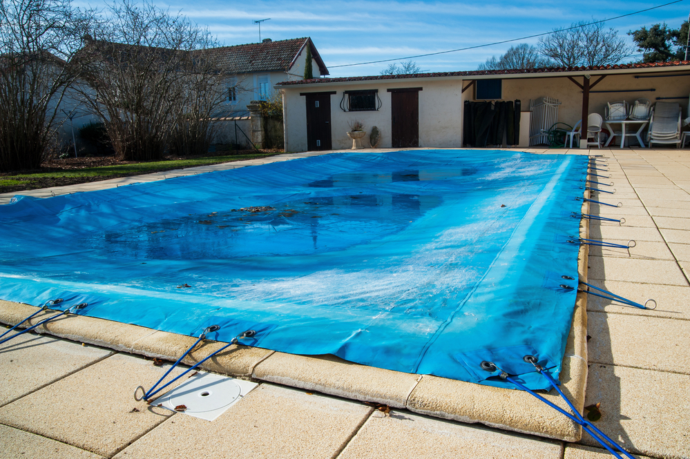 winterized pool with pool cover
