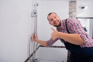 A bathroom remodeling contractor in a bathroom