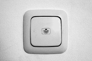 A white color light switch. There are major steps involved in carrying out a bathroom remodeling project