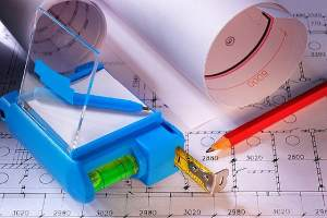 Basement remodeling contractor tools on a blueprint