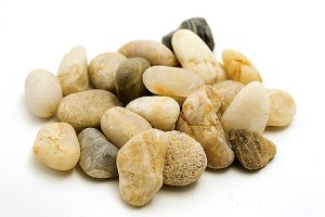 A heap of smooth pea gravel. Pea gravel is a very popular choice for the top layer
