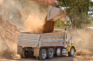 dump truck getting loaded with unscreened fill dirt