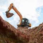 Excavator digging a trench. There are affordable methods of fill dirt removal