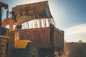Front end wheel loader loading #57 stone