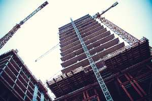 Heavy duty tower crane on building construction site. #57 stone is one of the preferred construction materials