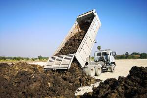 Landfill by flatbed truck. The simplest way to fill dirt disposal