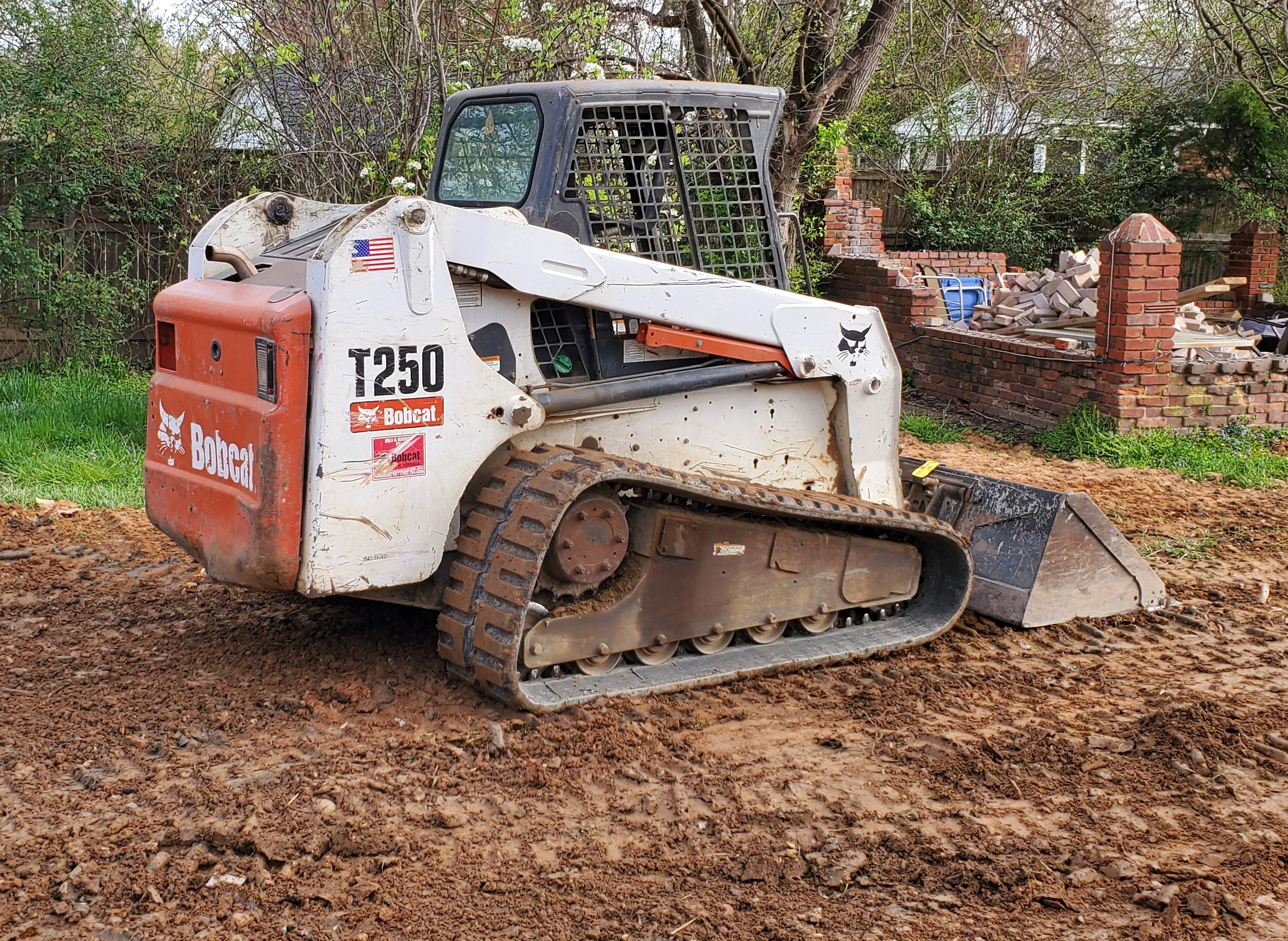 the dirt connections bobcat rental near me can load full size dump trucks