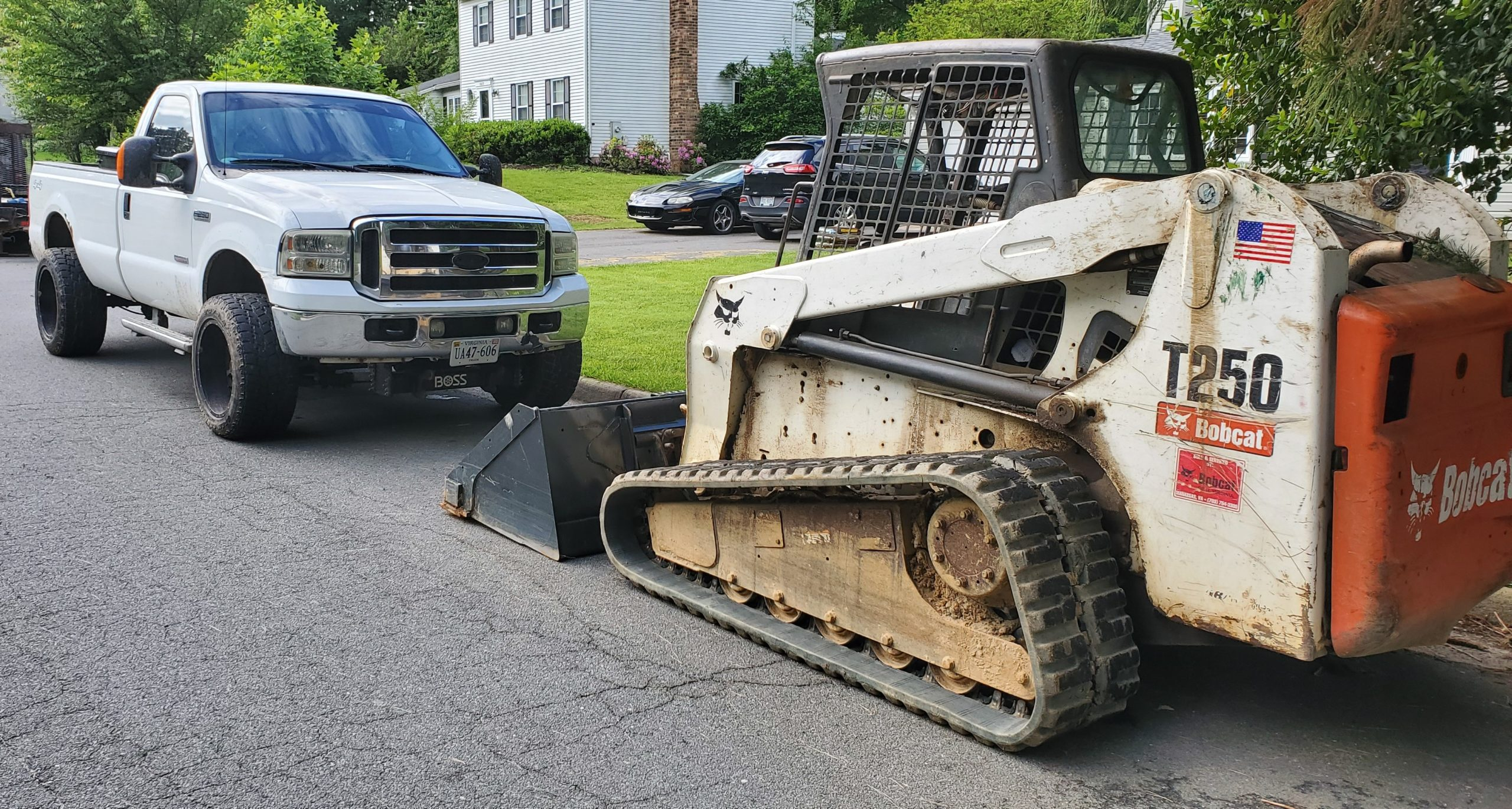 Bobcat skid loader rental with truck and trailer