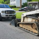 bobcat trailer, pick up truck and T-250 skid loader machine