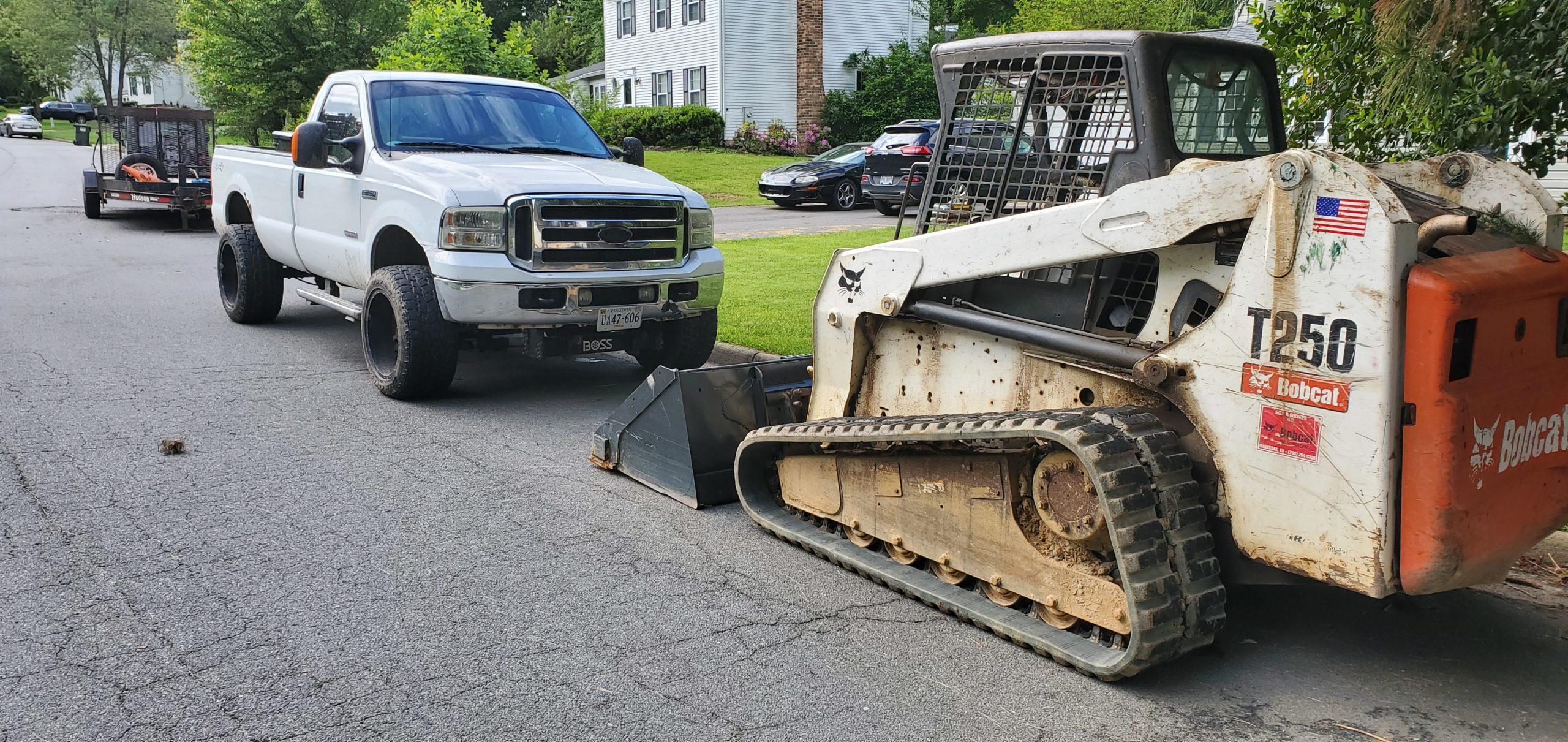 bobcat rental includes trailer, truck and T-250 Bobcat loader