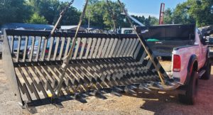 rock bucket segregates debris from the dirt