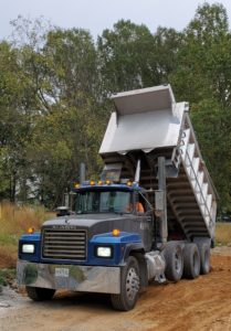 triaxle dump truck delivering structural fill dirt by dirt connections