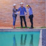 A pool removal contractors conducting site survey