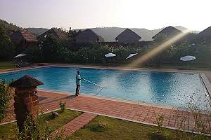 A worker cleaning pool. Having a swimming pool at home can be desirable