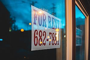 For rent sign on window pane. A home addition can also serve as a way to bring in additional income