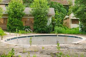 Water drained inground pool. A partial pool removal is also known as a fill-in because the pool is filled